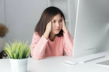 frustrated woman on PC